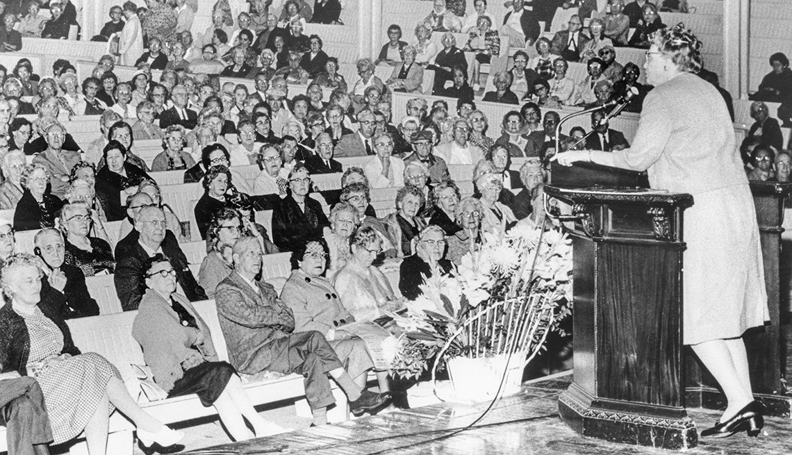 Ethel Percy Andrus on stage speaking to a crowd.