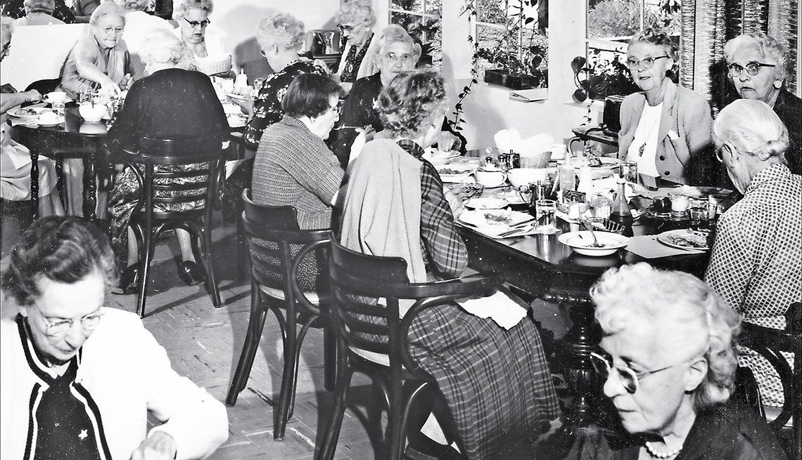 item 2 of Gallery image - Residents are served a meal at Grey Gables
