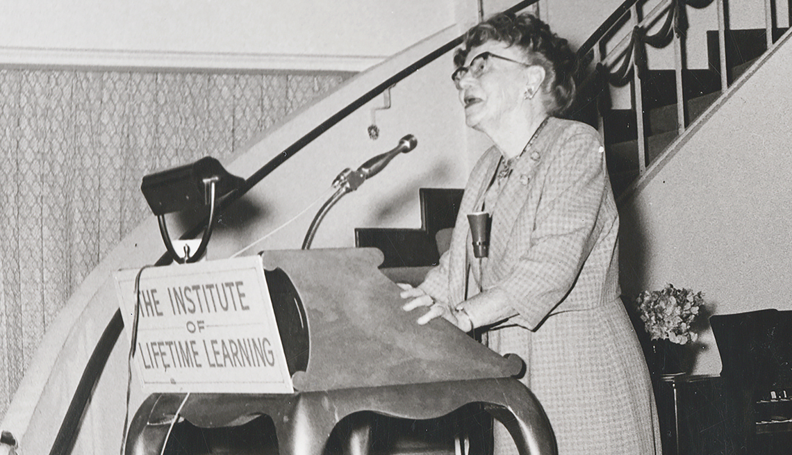 """item 3 of Gallery image - Dr. Ethel Percy Andrus standing at podium that reads """"The Institute of Lifetime Learning"""""""