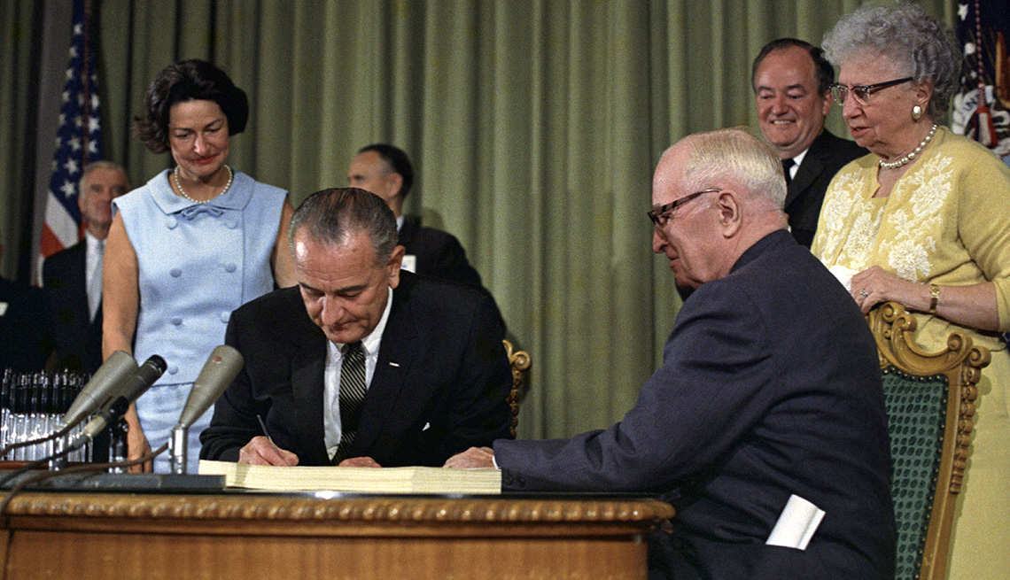 President Johnson signing Medicare bill.