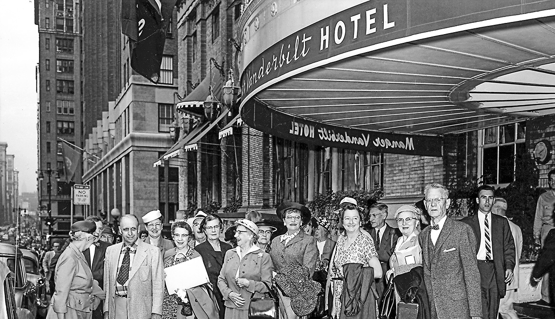 Group of people standing outside the Vanderbilt Hotel in New York City.