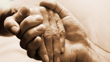 Young and Elderly Person Holding Hands