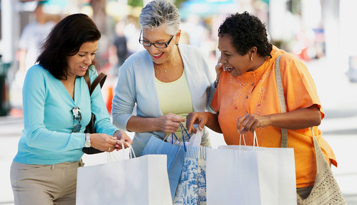 Group of mature woman with shopping bags, AARP Products and Services