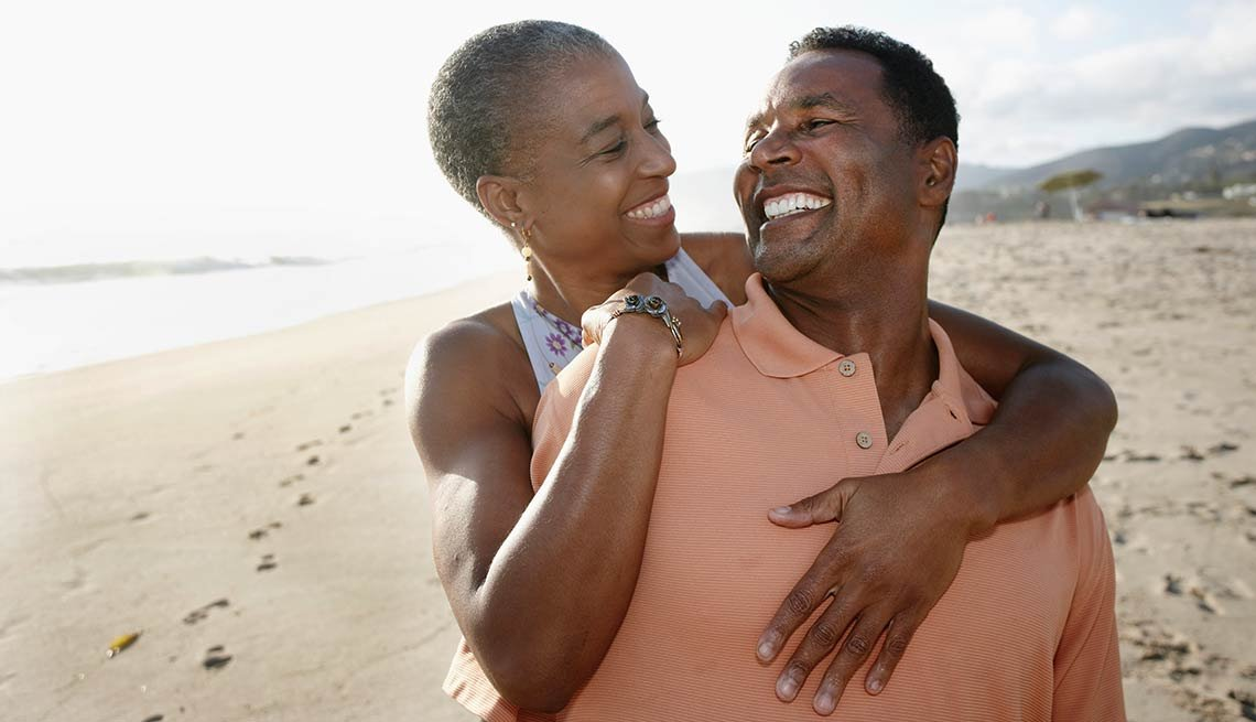African American couple on beach, AARP Services, Inc.  ASI