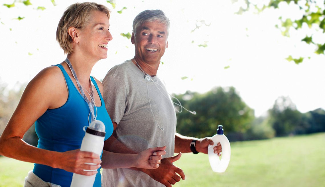 Mature couple jogging, AARP health