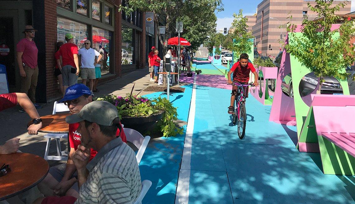 AARP Iowa volunteers repainted one block in the city of East Village