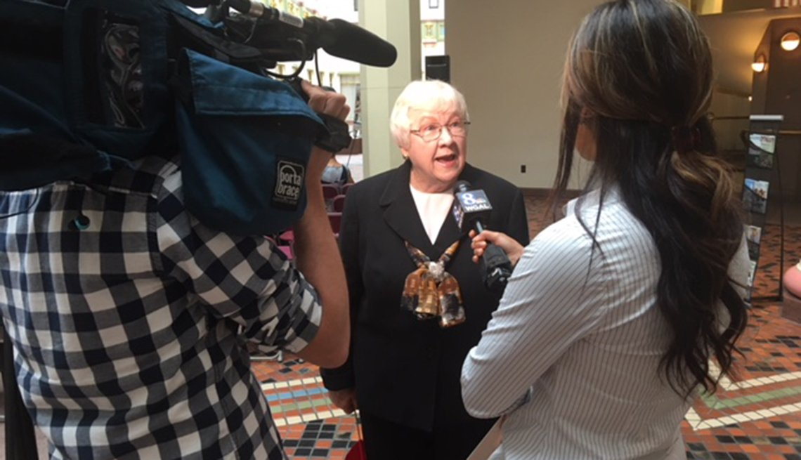 Mary Bach speaking with reporters