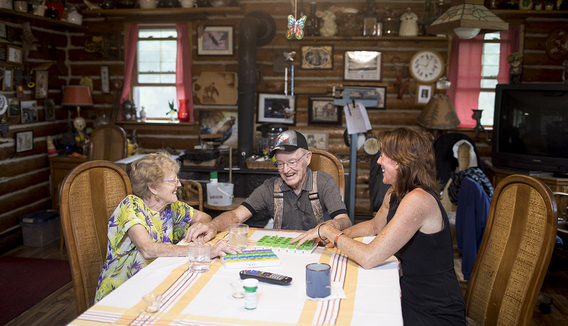 Sherrie Palm discusses their prescriptions with her parents, Joan & Phil Kastner, in their home in Mauston, Wisconsin, on Monday, Sept. 19, 2016. Photo by Ackerman + Gruber@ackermangruberSherrie Palm with her parents, Joan & Phil Kastner, at their home in