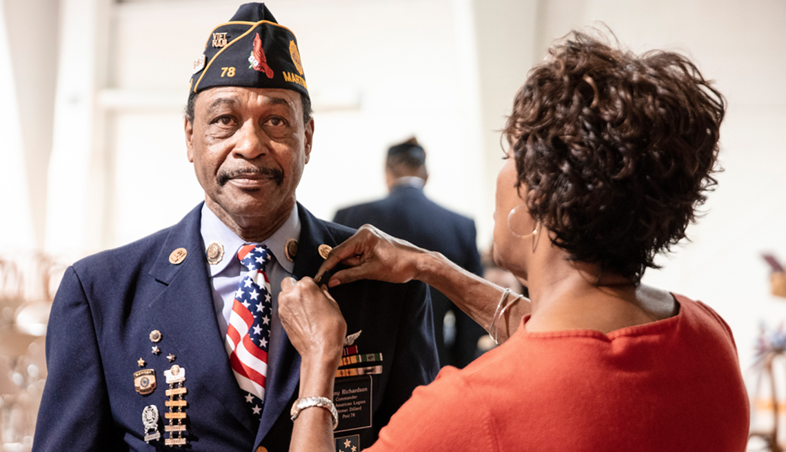 Male veteran receives a military pin during a ceremony