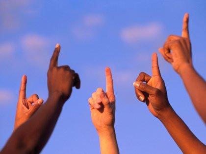fingers held aloft