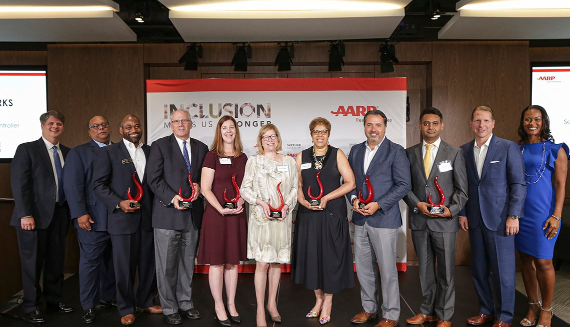 Seven award winners from A A R P 3rd Annual Supplier Diversity Awards and Recognition Program holding their awards