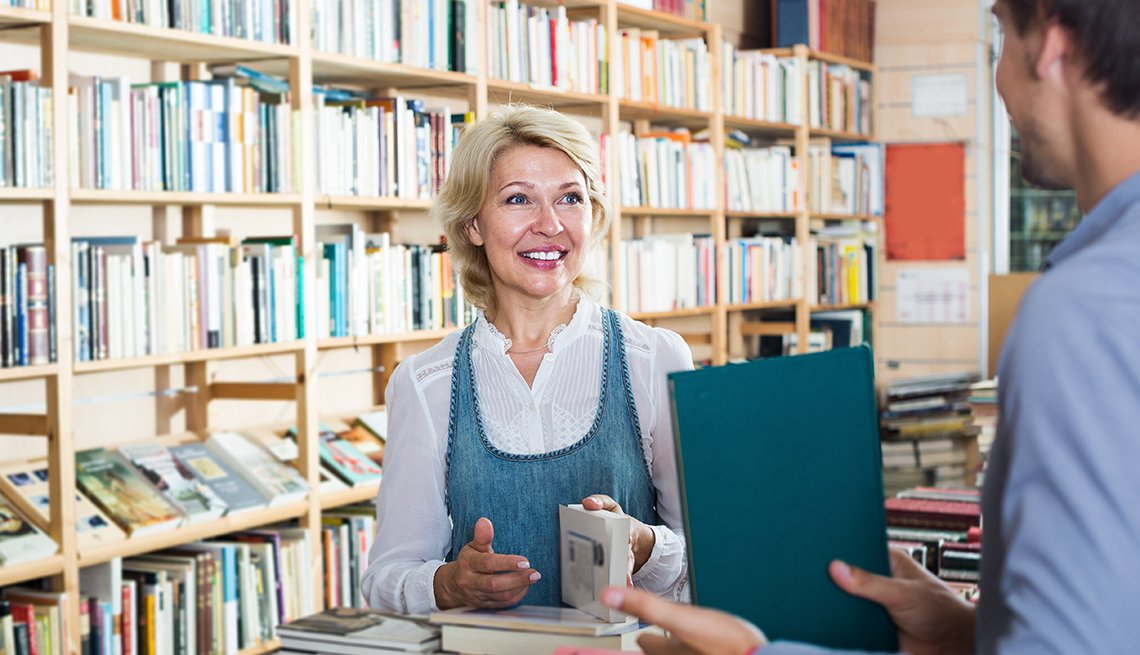 Woman Shopping Bookstore, Clerk Offers Book, NRTA Protecting Teacher's Retirement Security