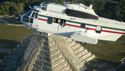 helicopter flying over ruins, a scene from the movie, Mexico: The Royal Tour