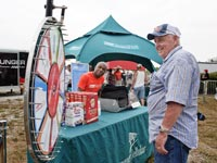 A man spins a wheel at the AARP Roadshow on July 29, 2011 at the Lucas Oil Raceway in  Indianapolis, IN.