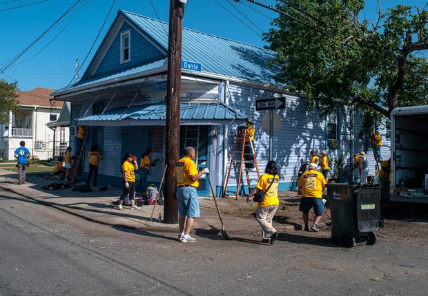 painting blue house, AARP Life@50+ Volunteer Day