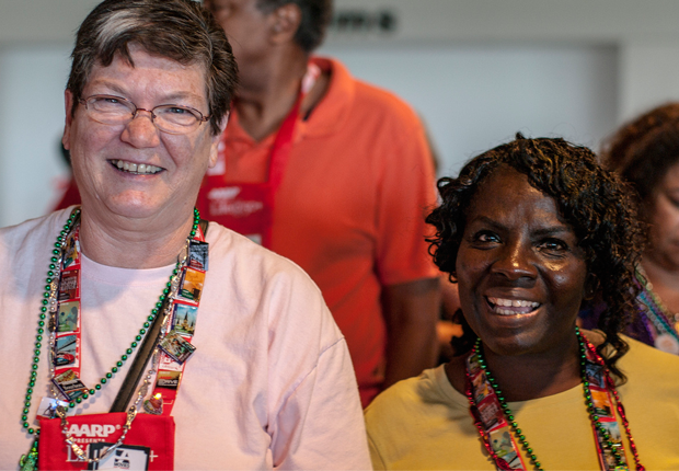 two smiling volunteers, AARP Life@50+ Volunteer Day
