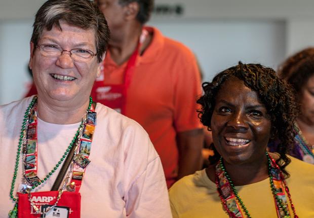 two smiling volunteers, AARP Life@50+ Volunteer Day