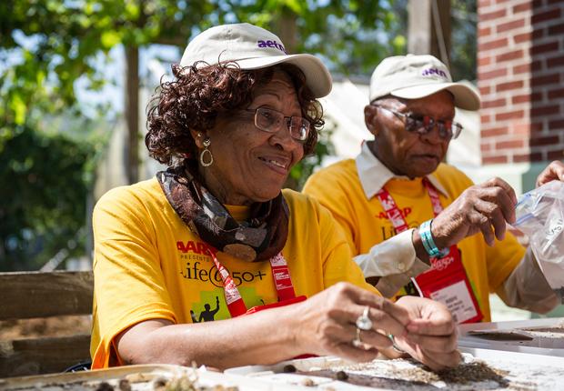 two volunteers outside, AARP Life@50+ Volunteer Day