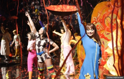 Performers on stage with umbrellas, Life@50+ Las Vegas Entertainment: Cirque du Soleil LOVE