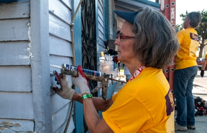AARP volunteer repairing a house at Habitat for Humanity New Orleans