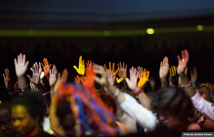 Audience members raised their hands and bowed their heads in praise at the gospel concert held during the Life@50+ National Event & Expo in Atlanta. (Photo by Kendrick Brinson)