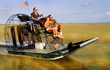 Riding a airboat over wet sea of grass in Everglades National Park, Florida.