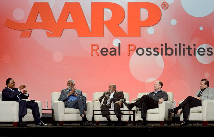 """New England sports legends (from right) Mike Eruzione, Steve Grogan, Luis Tiant and Bill Russell took the stage to reflect on their accomplishments both in and out of sports. AARP Community Ambassador James """"JB"""" Brown (far left) moderated this panel."""