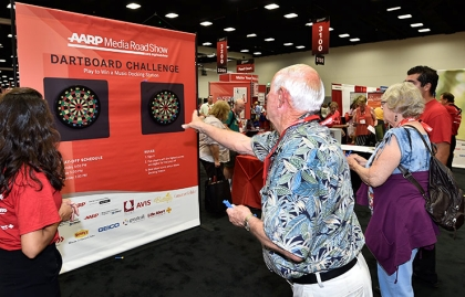 Ideas@50+ attendees take the Dartboard Challenge at the AARP Media Road Show.