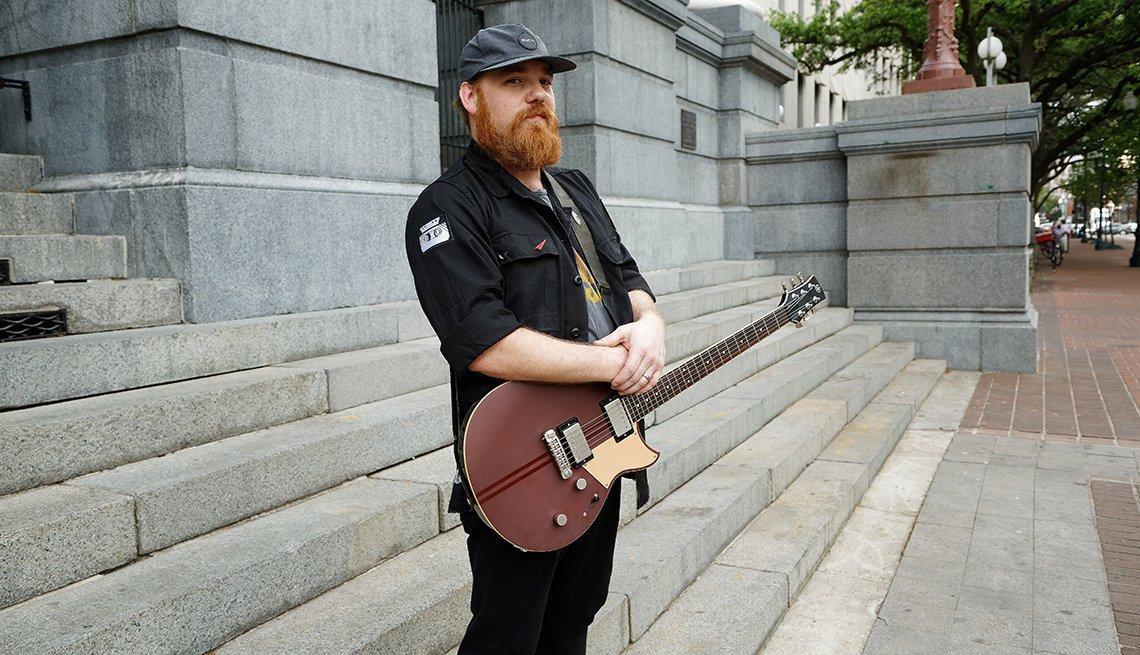 Marc Broussard holding a guitar