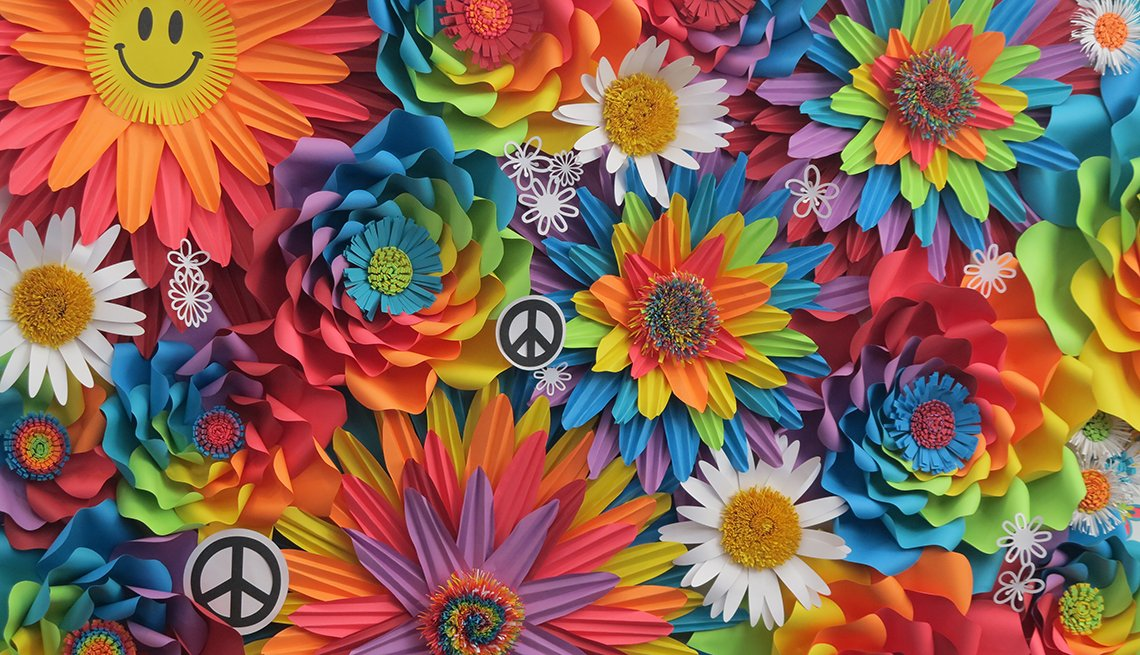 Collage of bright colored flowers, peace signs and smiley faces