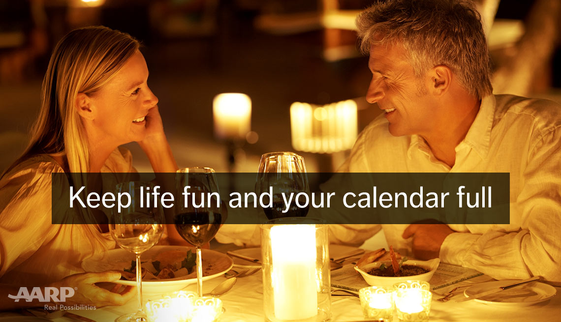 A young caucasian couple enjoy a dinner outdoors with text that reads keep life fun and your calendar full.