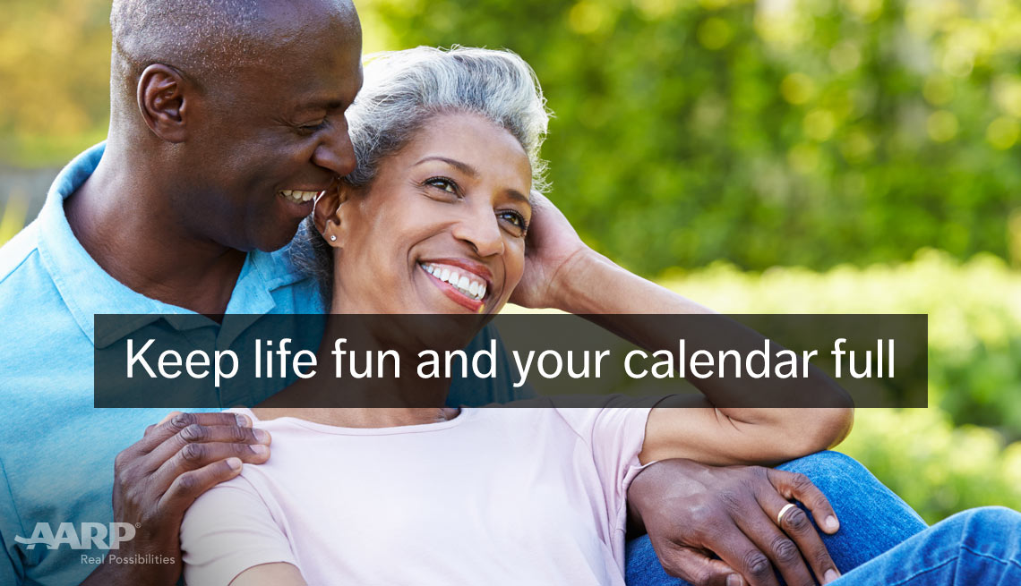 A middle aged african-american couple lean against each other and smile with text that reads keep life fun and your calendar full.