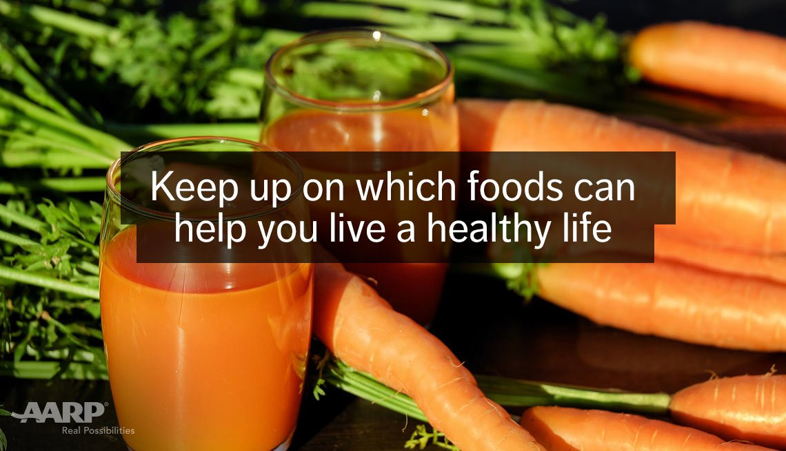 Glasses of carrot juice, fresh carrots. Keep up on which foods can help you live a healthy life