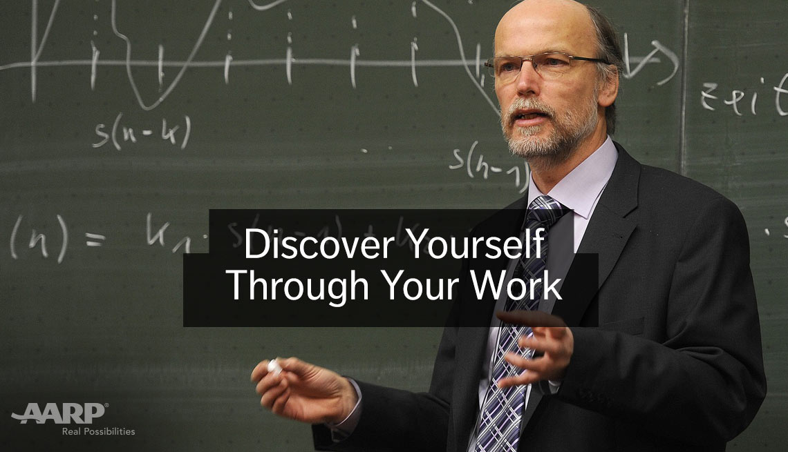 Discover yourself through your work, Older caucasian man with glasses at chalk board with equation