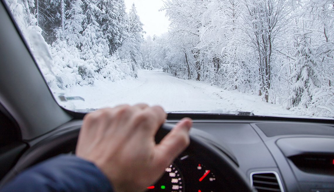 male driver, snowy road, AARP Auto, Winter Driving Tips,