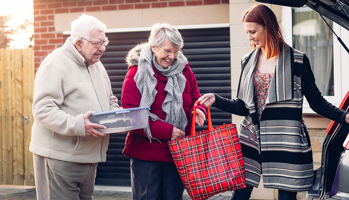Elderly couple unloading car trunk, Transportation Options for Non-Drivers