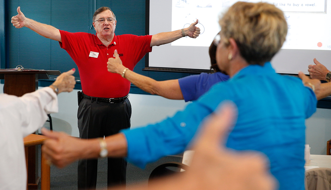Tom Hirsch, an AARP volunteer, teaches the AARP Smart Driver class participants about peripheral vision by instructing them to slowly bring their thumbs around into their field of vision