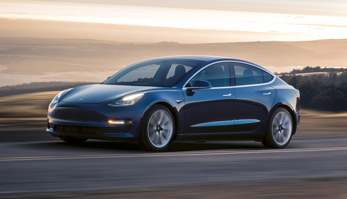 Image of a Tesla Model 3 driving on a mountain road