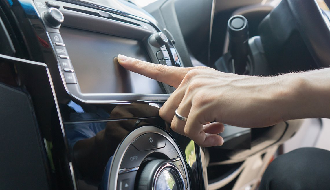 Woman using touch screen in car