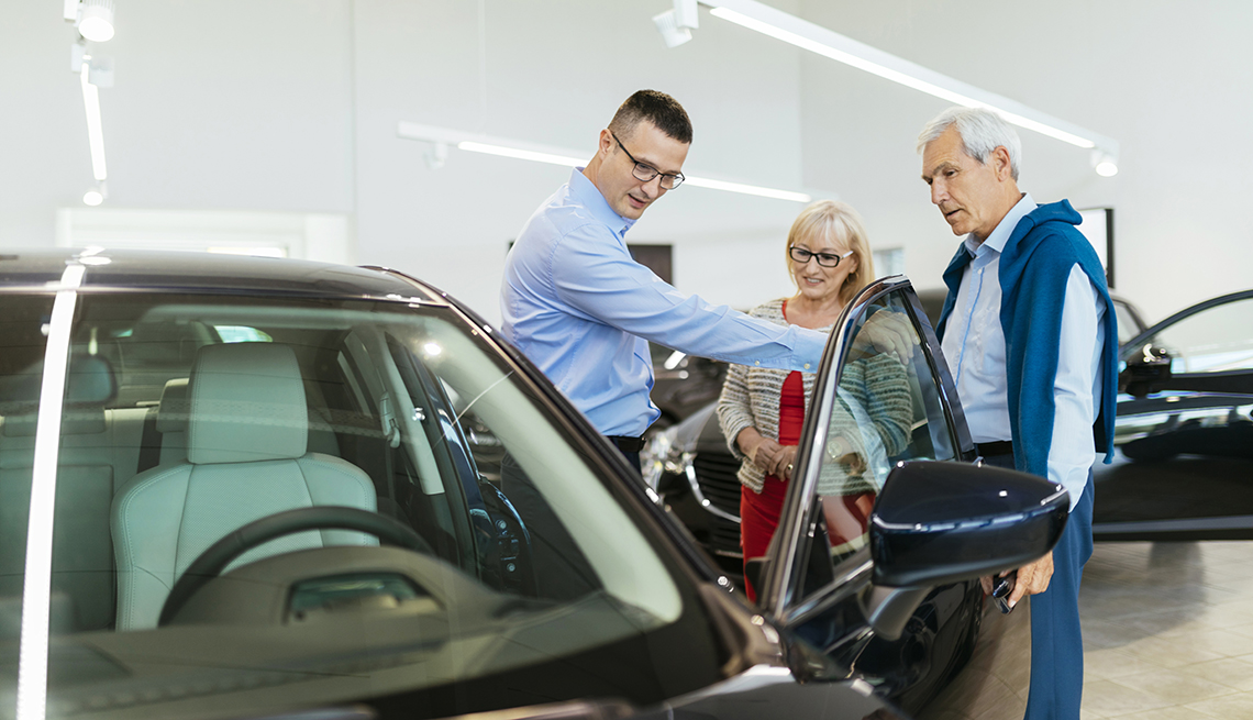 boomers shopping for a new in with salesman in a dealership