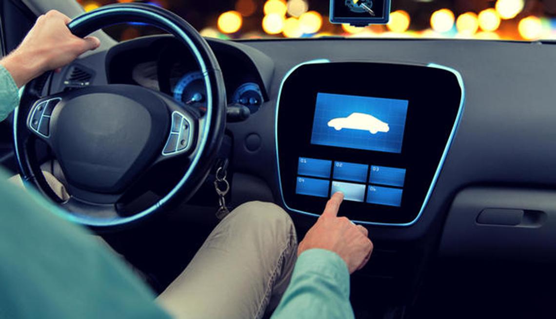 Man using touchscreen dashboard in car