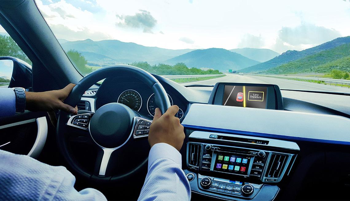 man behind the wheel of a tech savvy vehicle