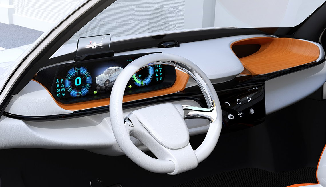 Closeup view of digital speedometer with HUD on wooden tray. Electric car's dashboard concept.