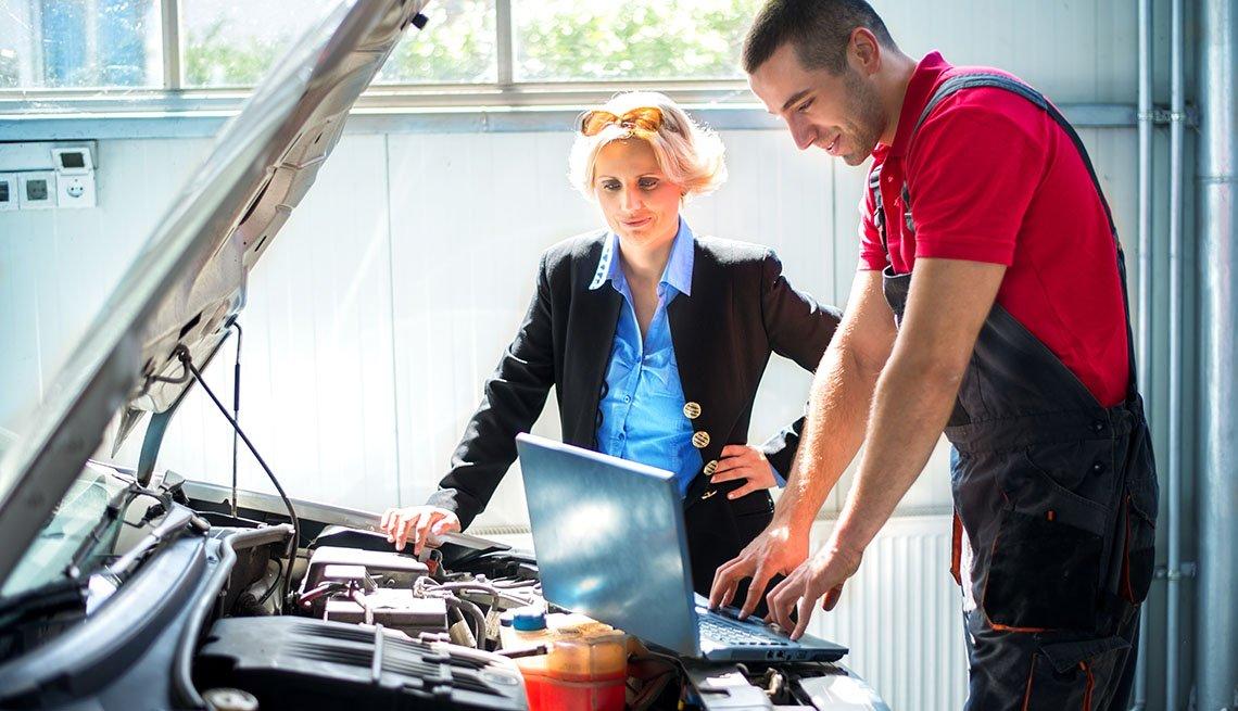 Auto mechanic with woman customer.