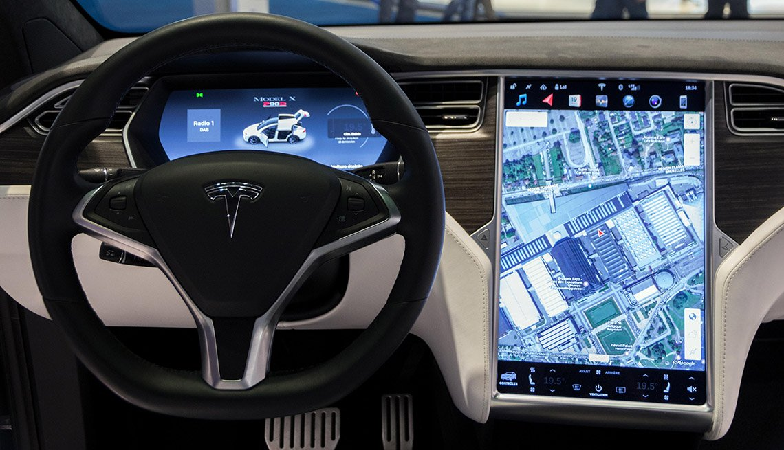 Interior dashboard with navigation of Tesla vehicle