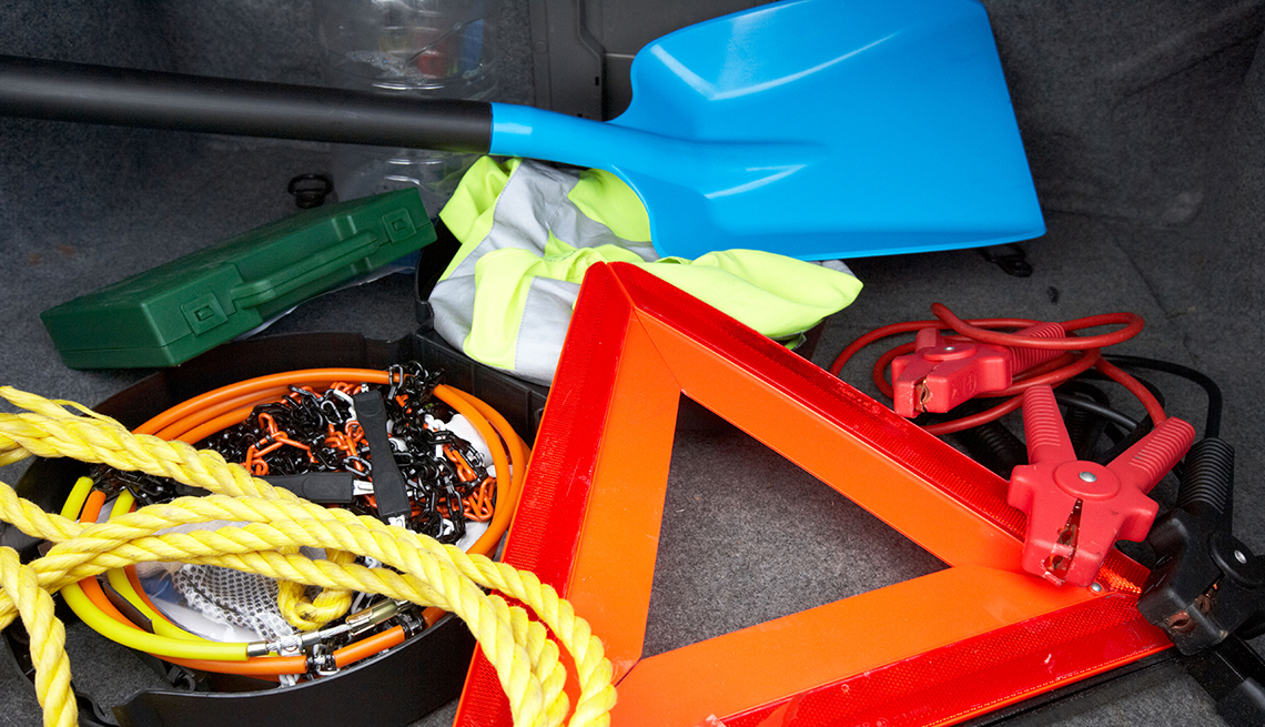 photo of shovel, jumper cable and other supplies to keep in car during winter