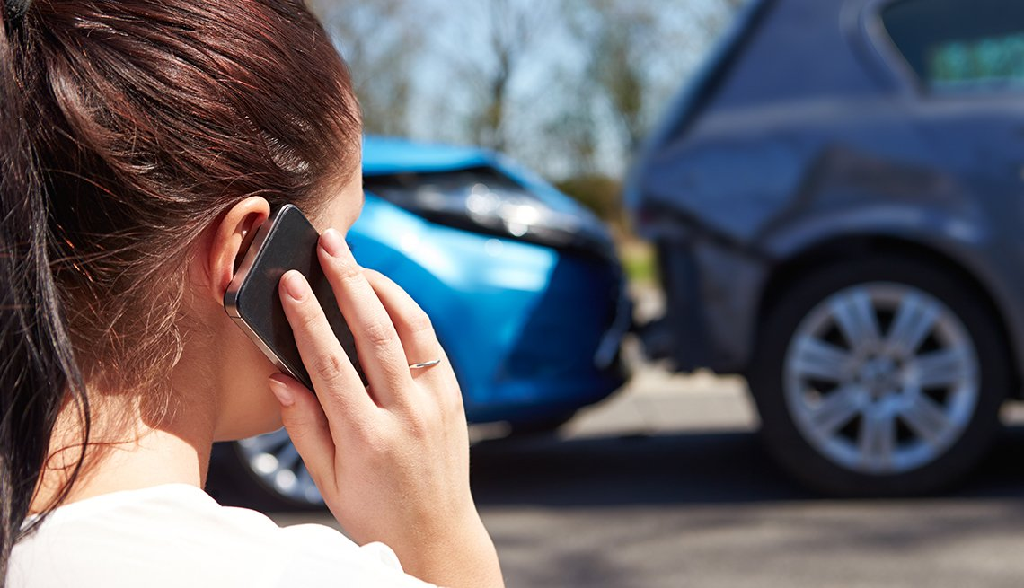 female calling car insurance company after an accident