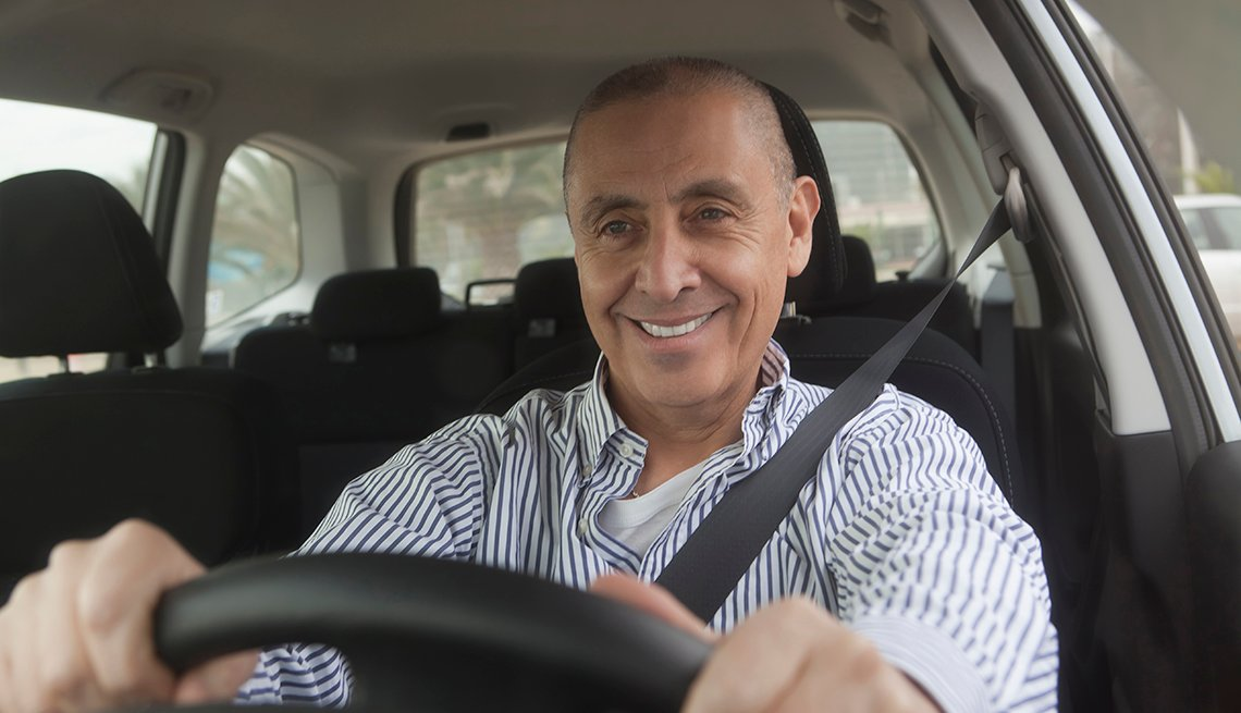 man behind the wheel of a car, wearing a seatbelt