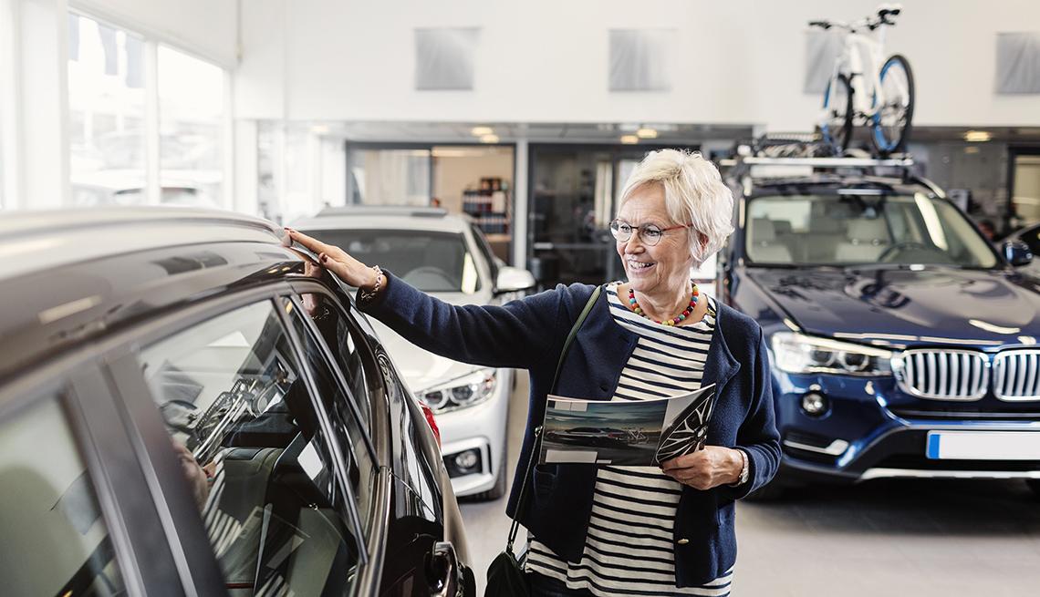 woman looking at car in showroom