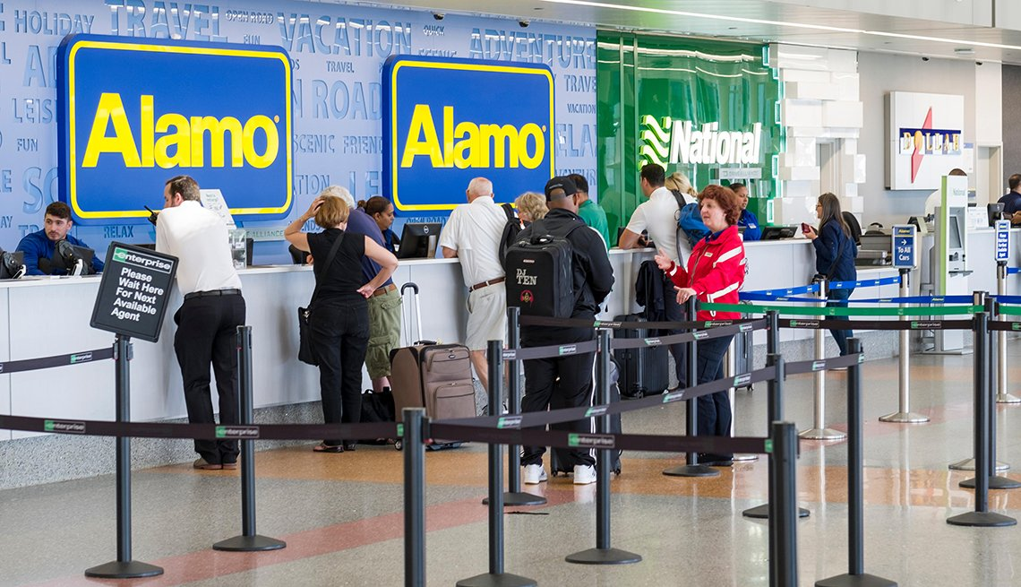 People standing at car rental counter in the Logan International Airport rental car center, Suffolk County, Massachusetts, USA